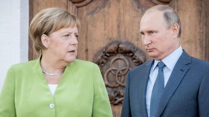 Putin və Merkel Donbasdakı vəziyyəti müzakirə etdi